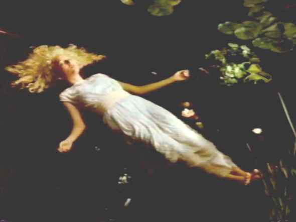 Virginia Madsen recreate Ophelia in this scene from the film Fire with Fire, 1986.